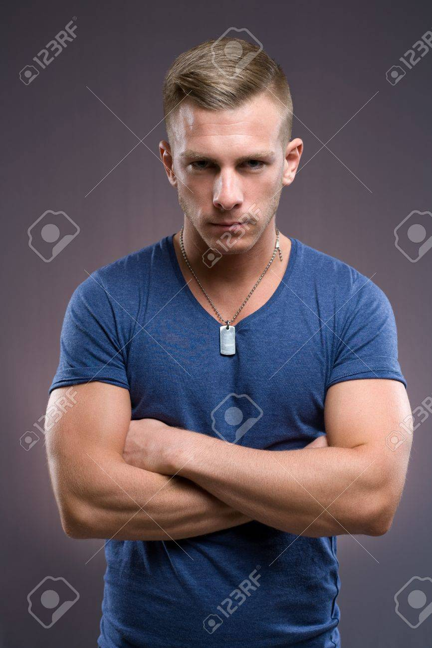 Portrait of masculine tough looking young man with serious expression and pose. Stock Photo - 12005127