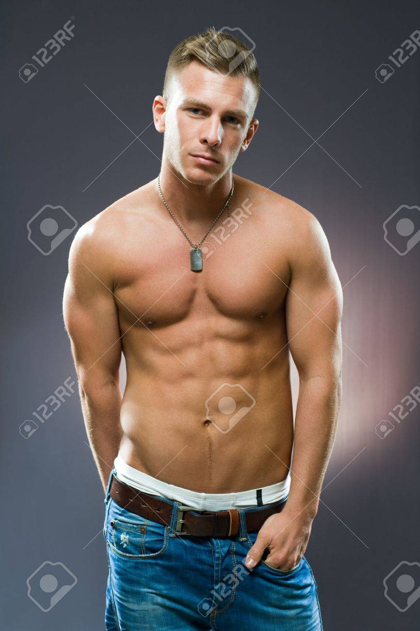 Half length portrait of a very fit, ripped young man. Stock Photo - 12028537