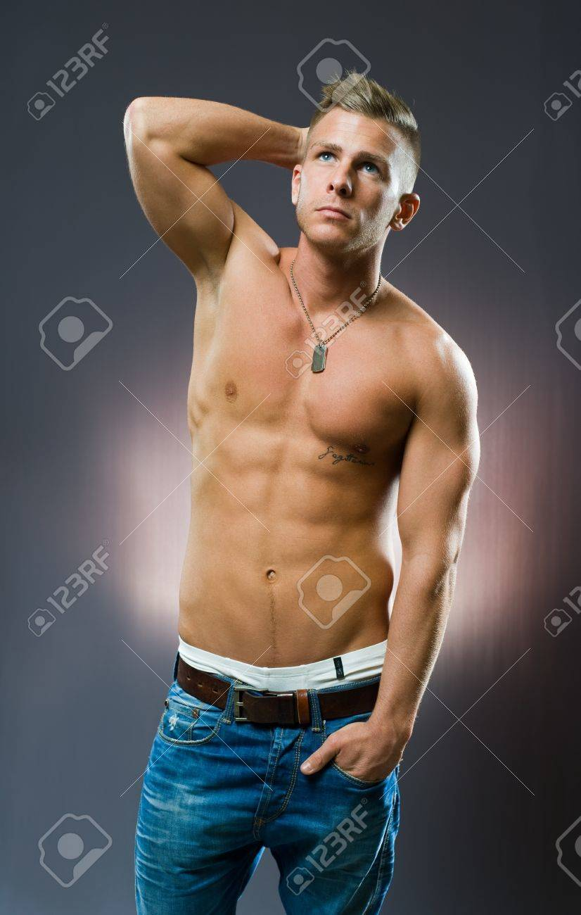 Portrait of a muscluar handsome young man posing. Stock Photo - 12028529