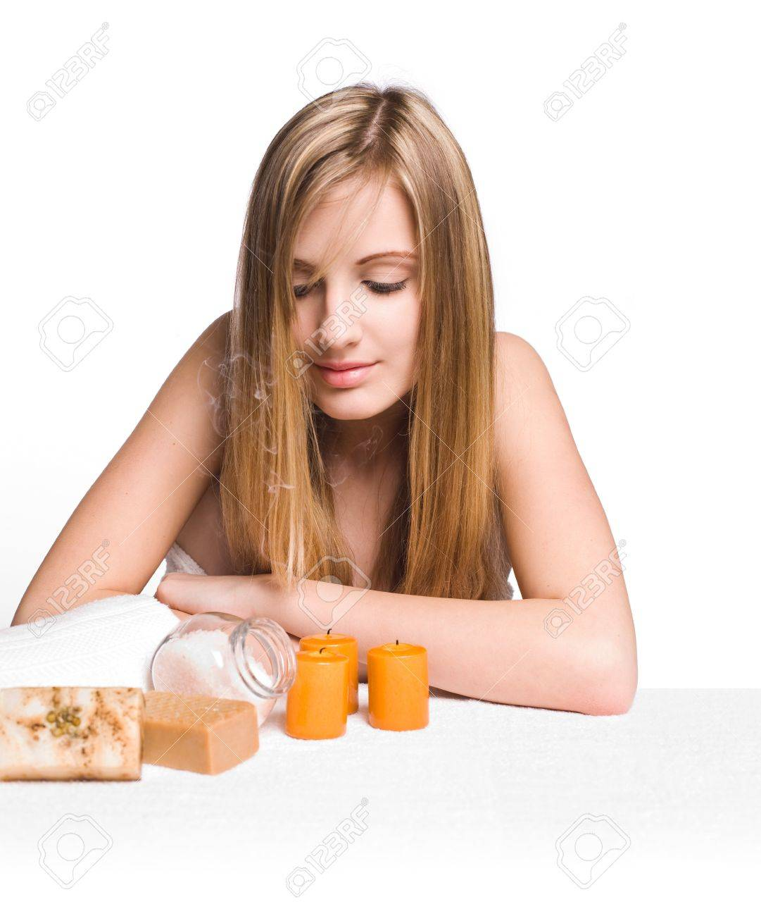 Portrait of a blond spa beauty smelling scented candle smoke Stock Photo - 12622174