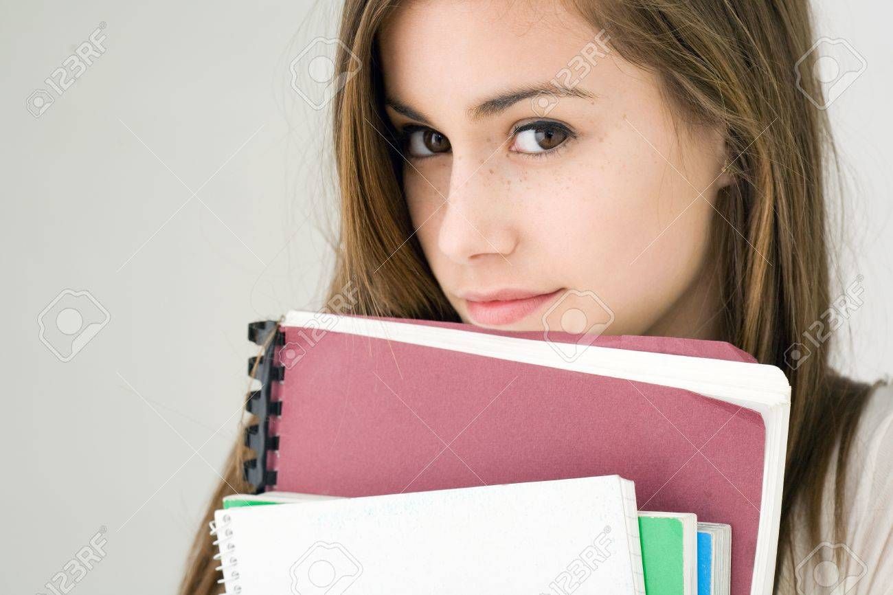Portrait of a very cute young brunette student girl. Stock Photo - 13454386