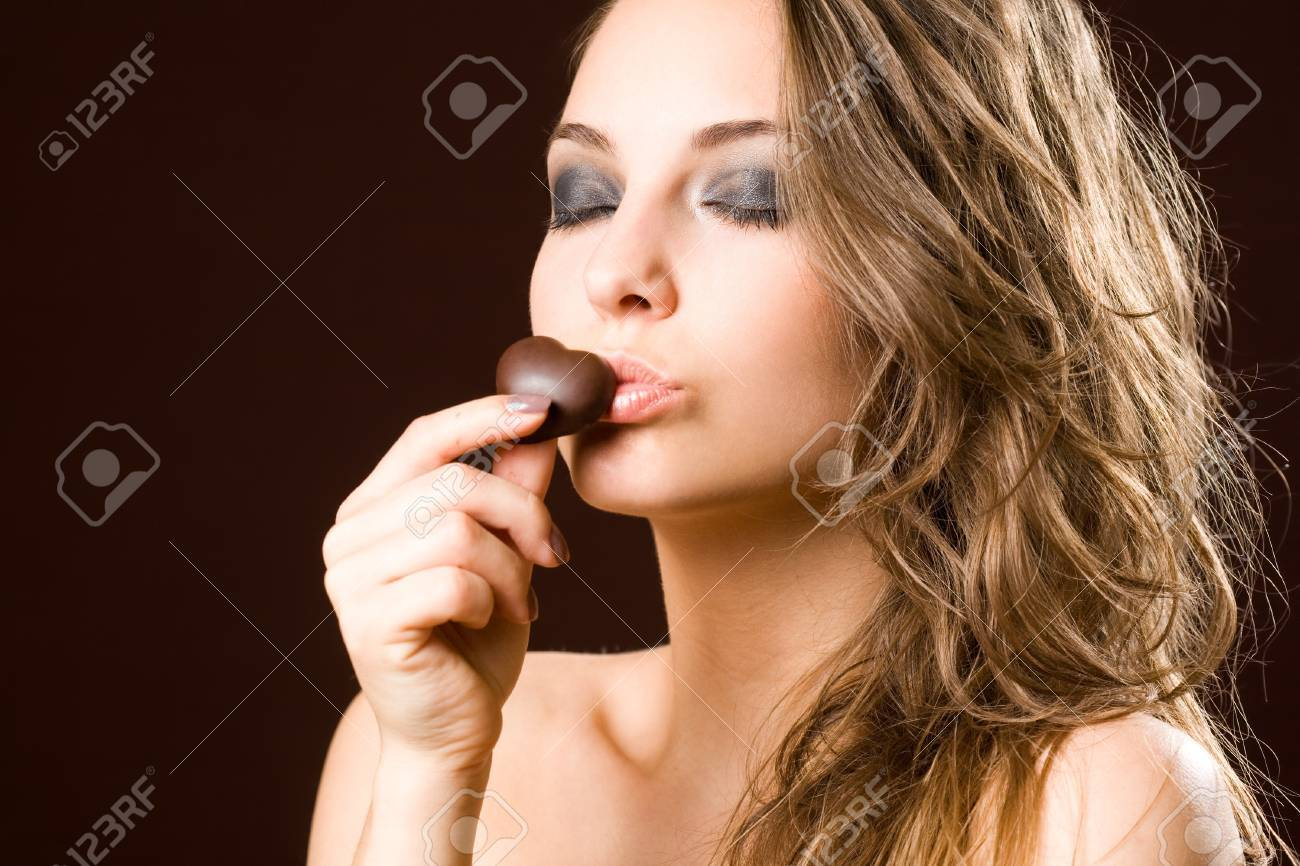 Portrait of a chocolate loving young brunette beauty - 14401855