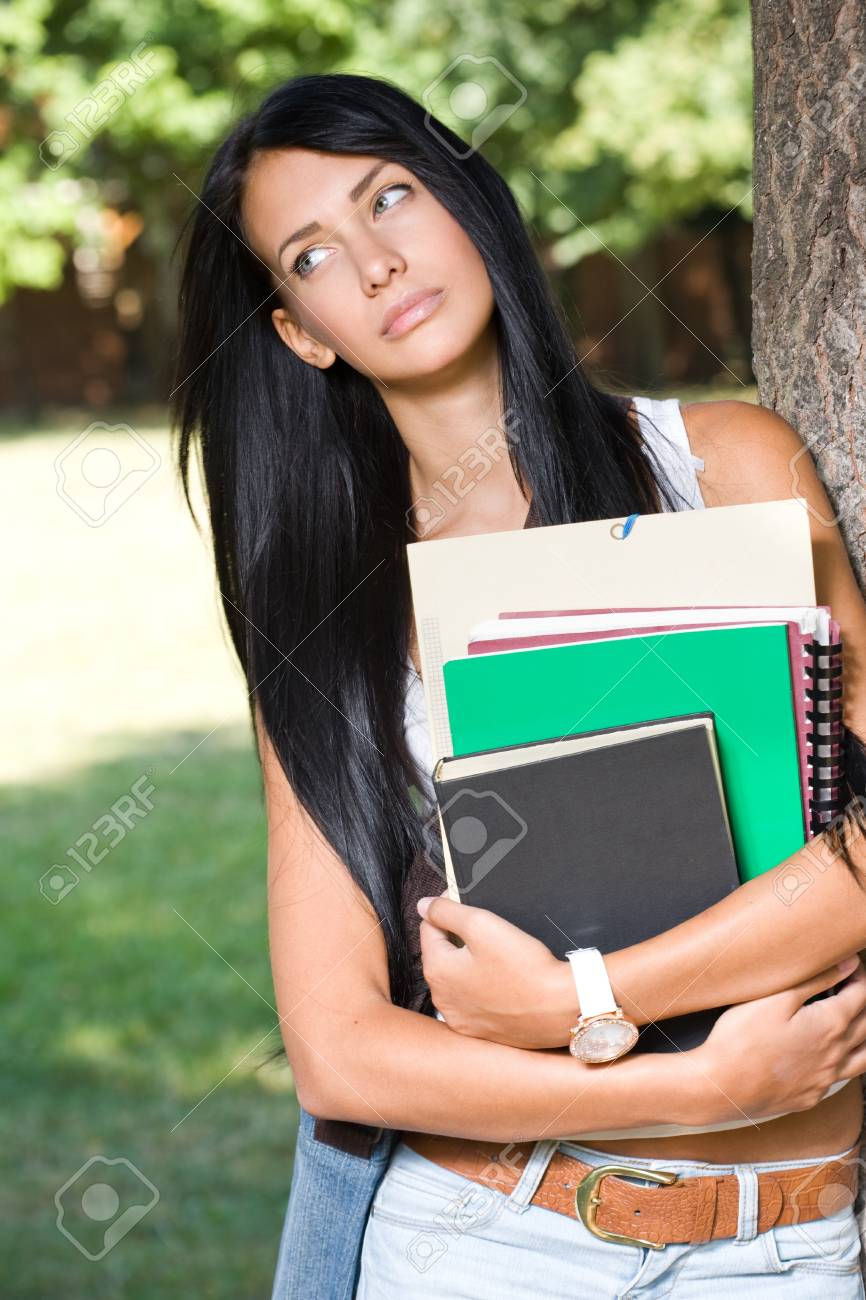 Outdoors portrait of a beautiful pondering thoughtful young student girl. Stock Photo - 15005353