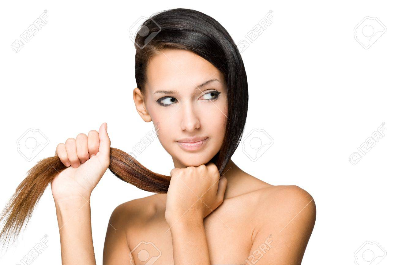 Closeup portrait of gorgeous young brunette woman showing of her shiny healthy hair. Stock Photo - 15389010