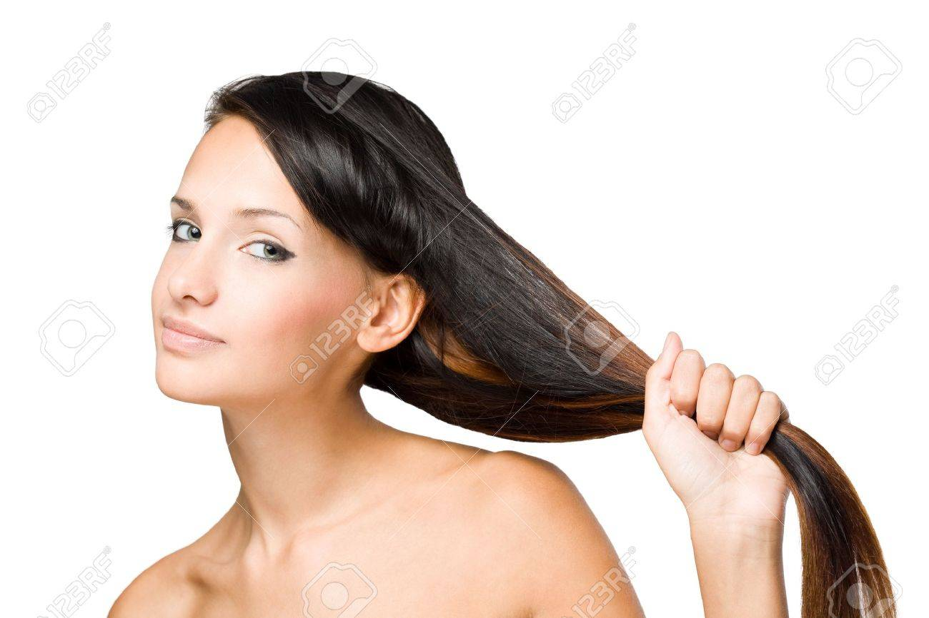 Closeup portrait of a brunette beauty with shiny healthy hair. Stock Photo - 15427891