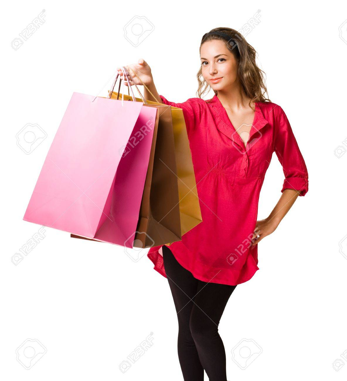 Beautiful young brunette woman with colorful shopping bags Stock Photo - 16143602