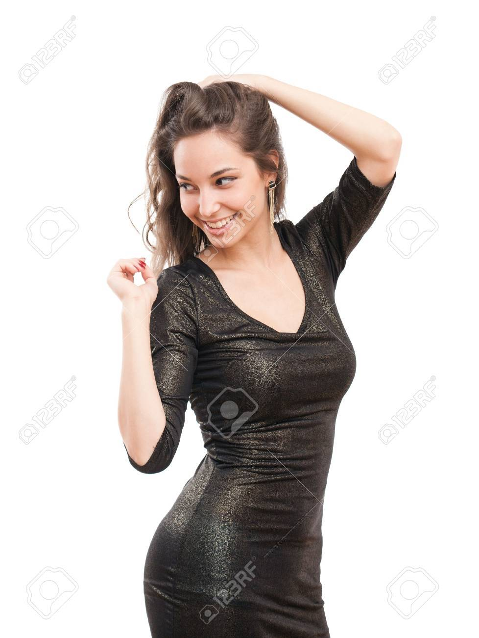286e7a9b279a Portrait of festive gorgeous young brunette in tight black sequin dress.  Stock Photo - 20728058