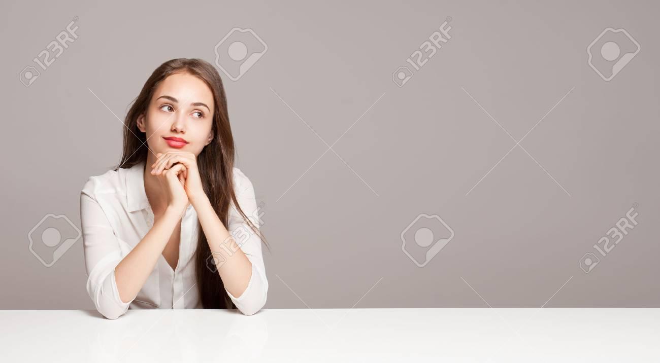 Portrait of a gorgeous young pensive brunette woman. - 44196047