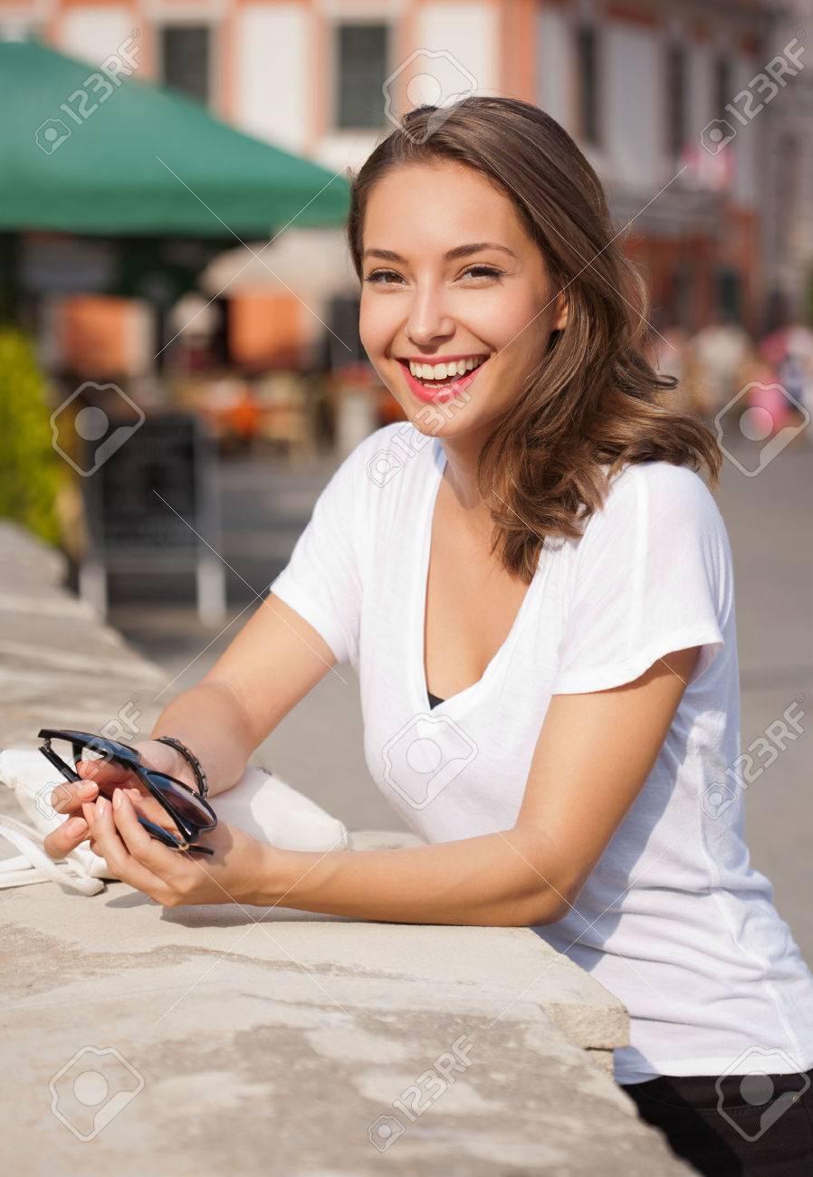 Portrait of a young brunette tourist woman taking photos. - 46512760