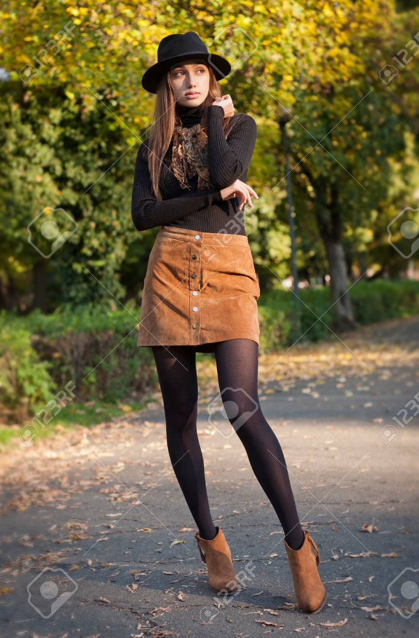 Portrait of a young brunette beauty in autumn clothes. - 47966551