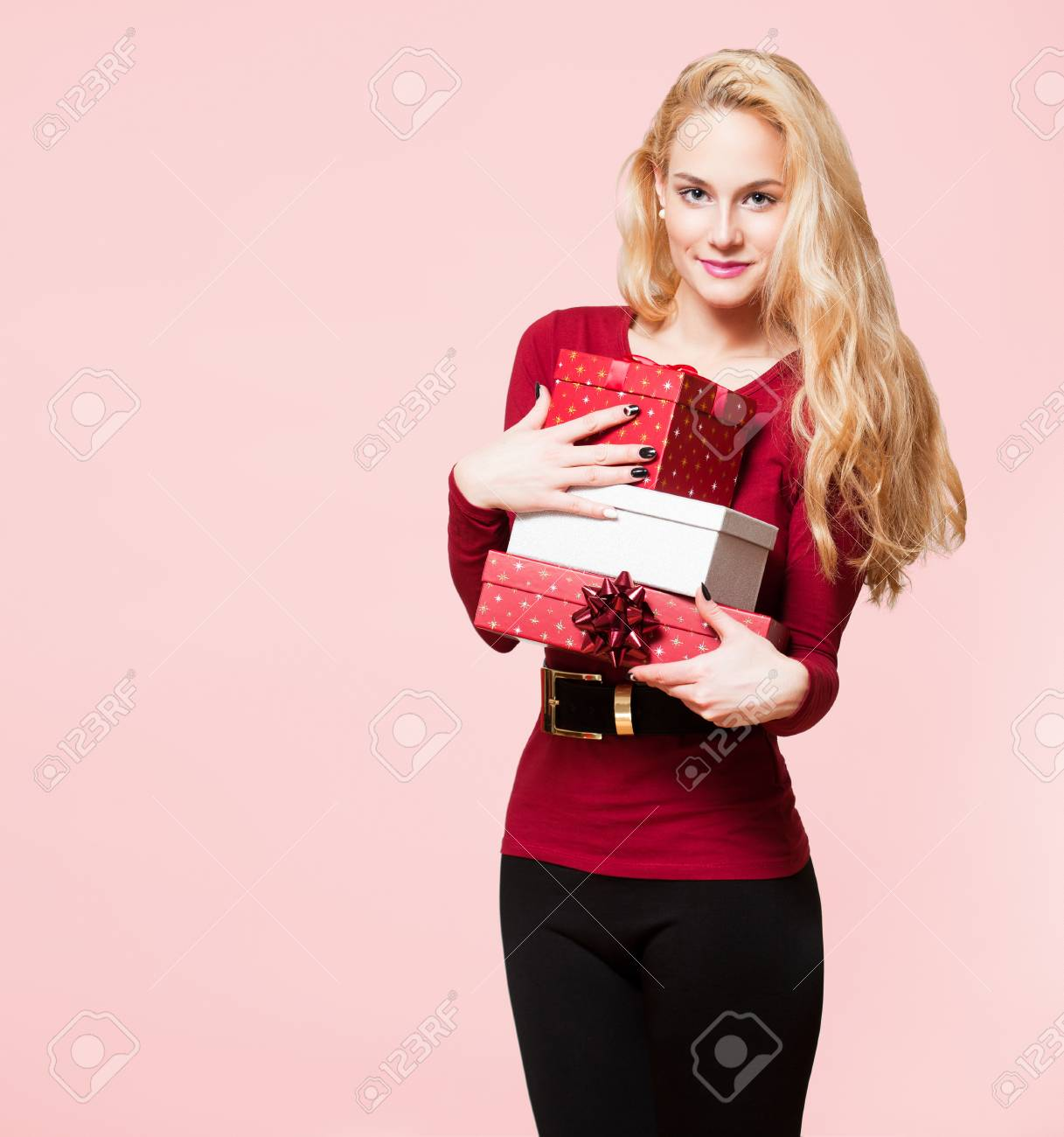 Christmas Beauty.Portrait Of A Blond Christmas Beauty Holding Gift Boxes