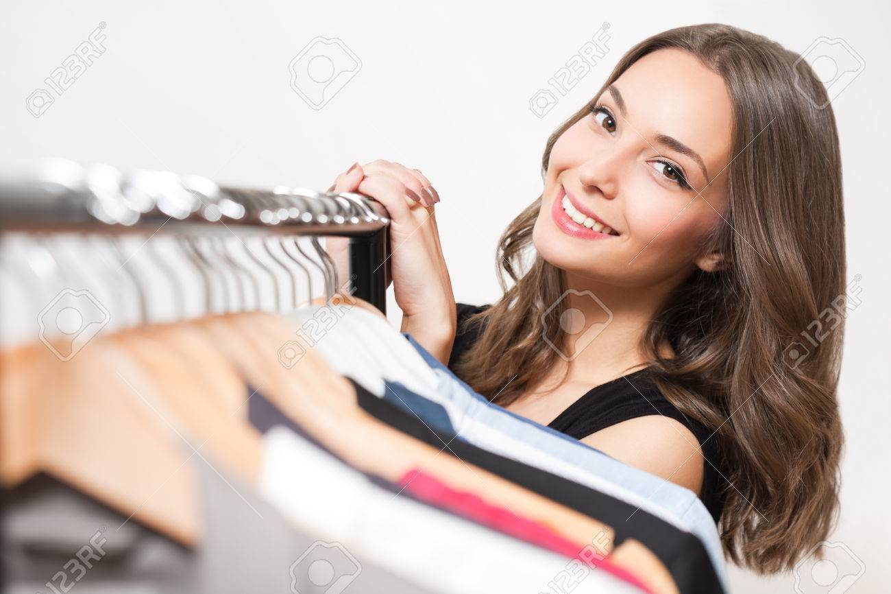 Portrait of a gorgeous young brunette woman shopping clothes. - 49008661