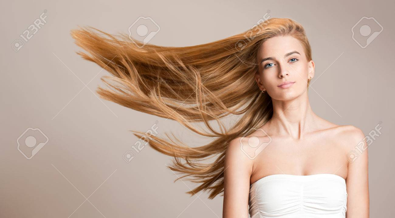 Portrait of a beautiful young blond woman with amazing flowing hair. - 52411007