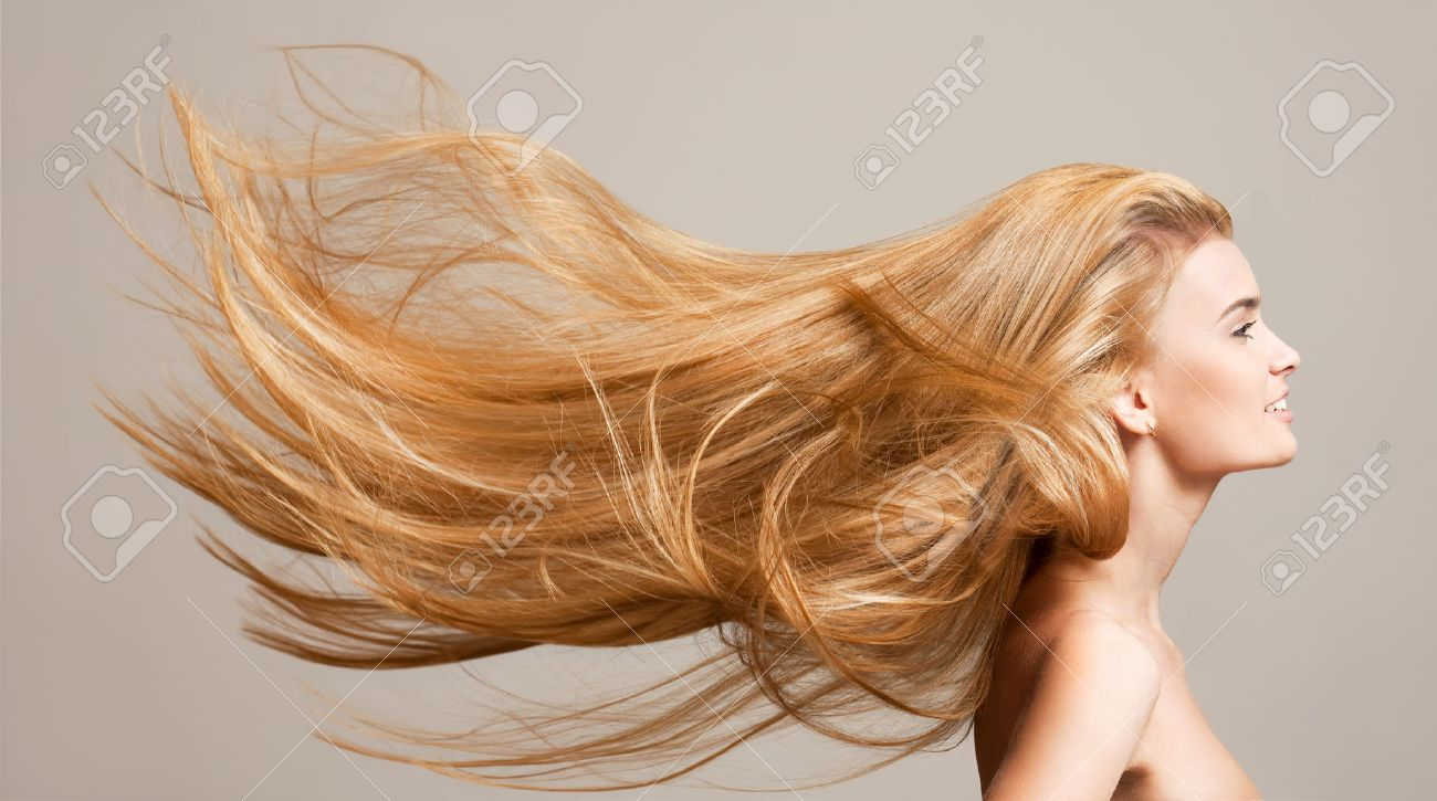 Portrait of a beautiful young blond woman with amazing flowing hair. - 52411009