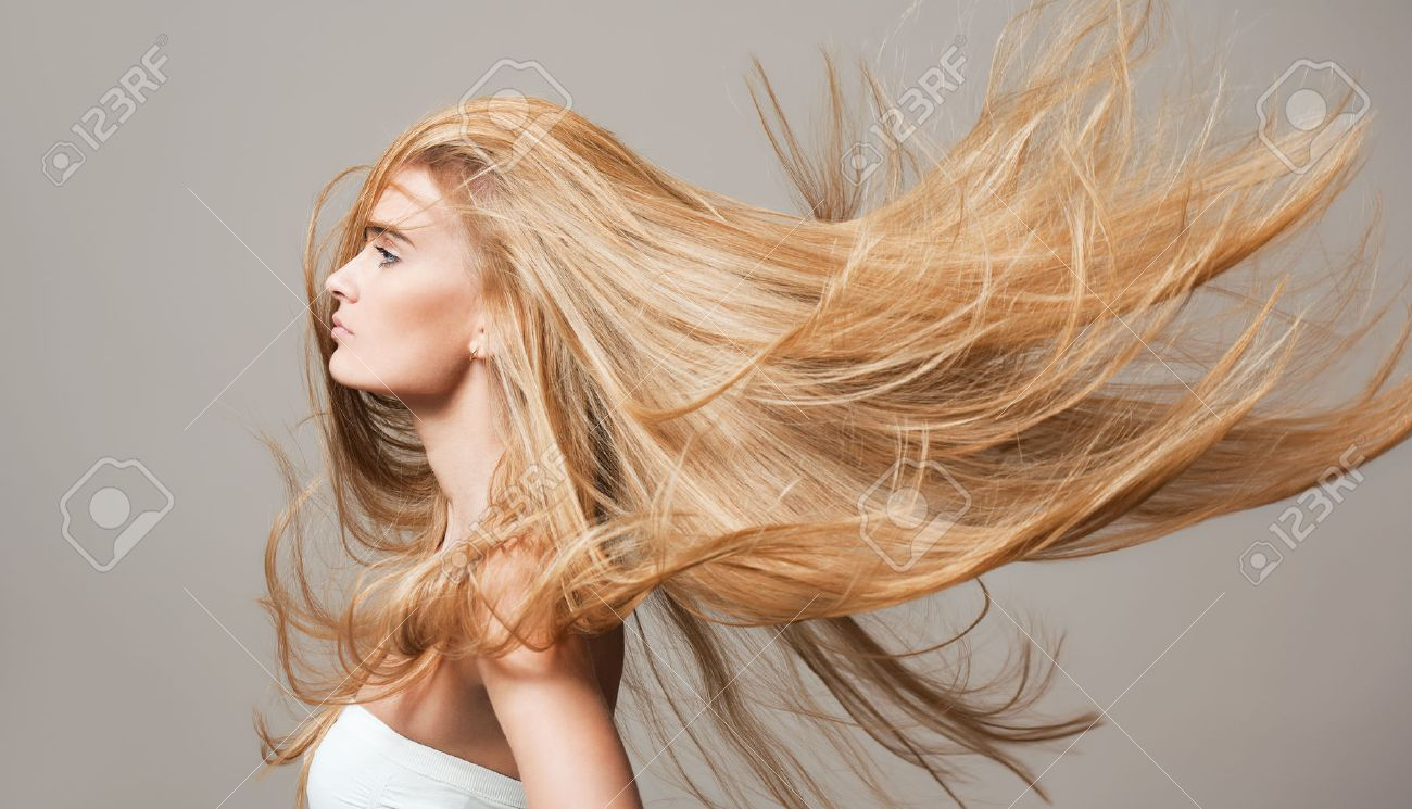 Portrait of a blond beauty with beautiful healthy long hair. - 52411076