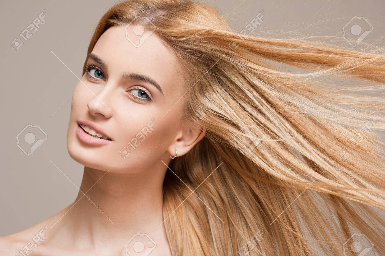 Portrait of a beautiful young blond woman with amazing flowing hair. - 55447145
