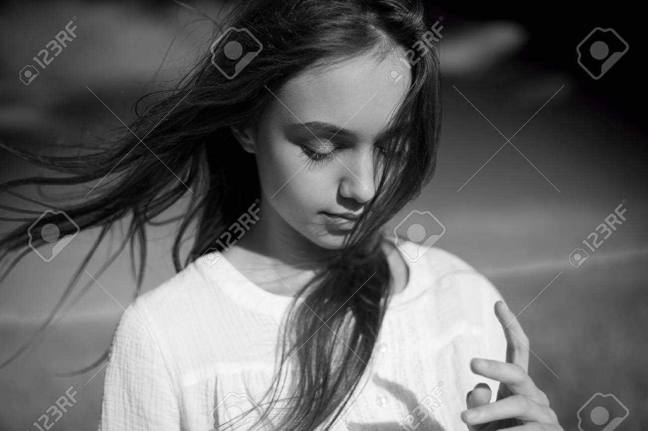 Artistic emotional black and white portrait of a young brunette