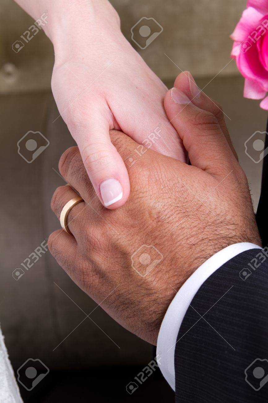 Newly wed couple holding hands and showing their love. Stock Photo - 8598768