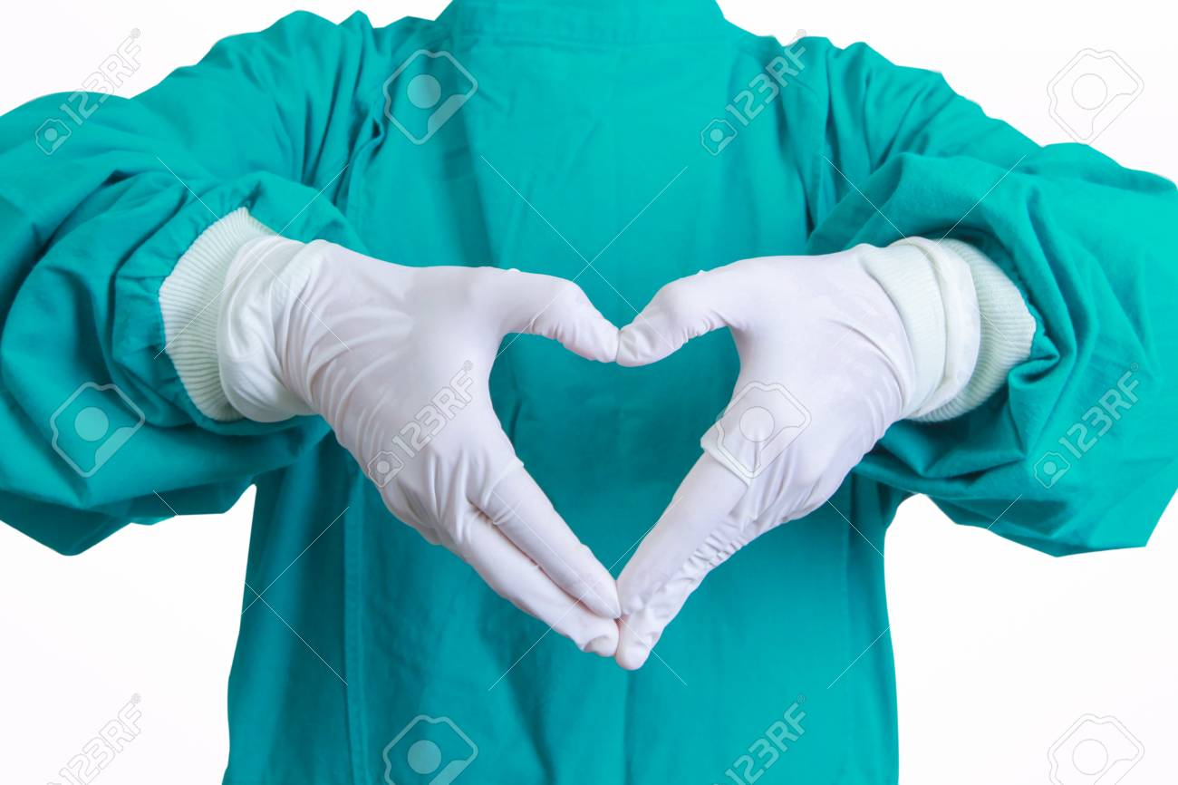 Heart Shape Hands Of Surgeon Doctor In The Green Gown On White ...