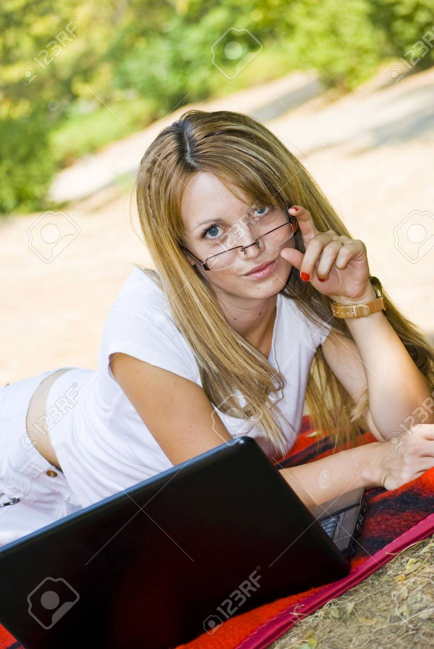 beautiful young woman working out with laptop or notebook Stock Photo - 5412765