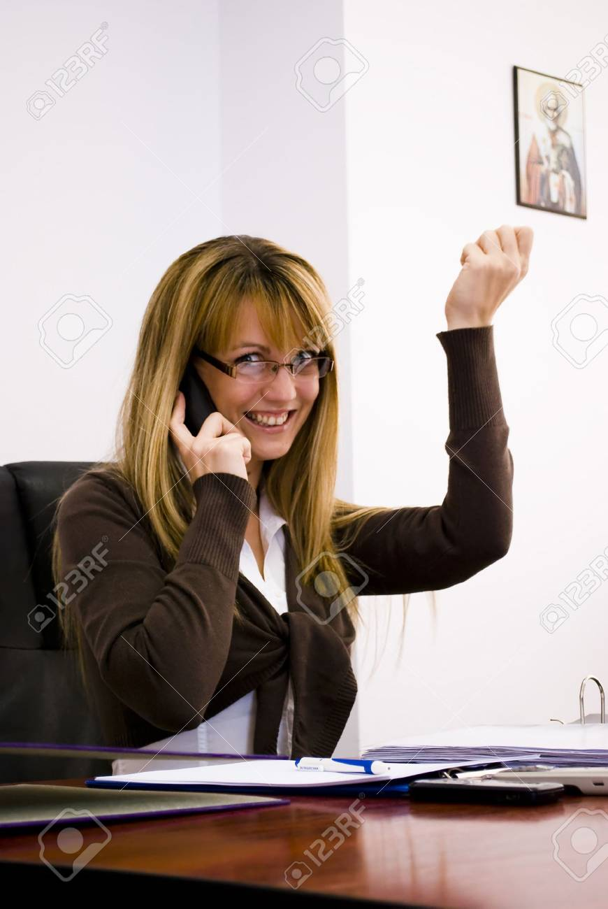 blonde businesswoman working and talking on phone Stock Photo - 6390556