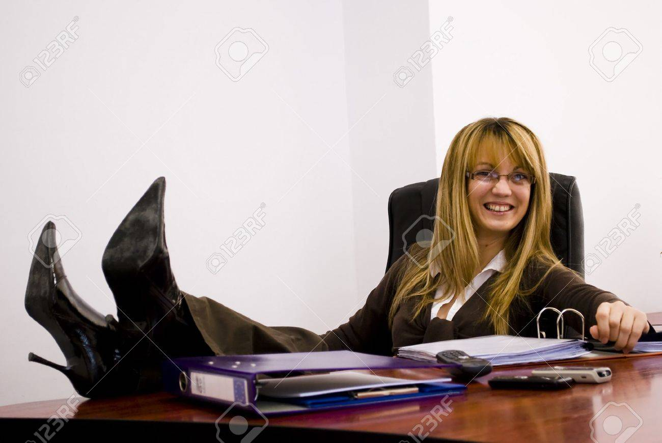 young attractive woman holding her legs over the table Stock Photo - 6506309