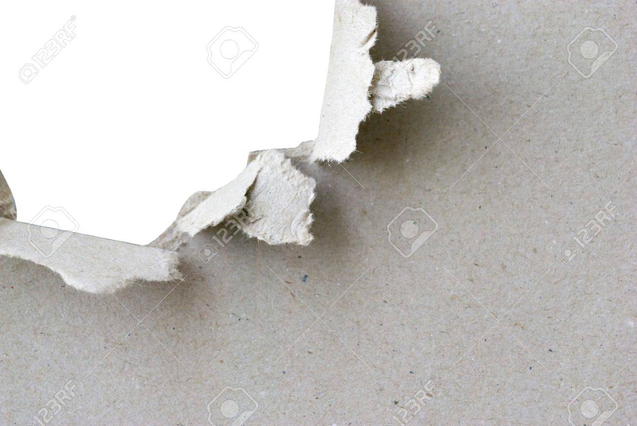 torn hole in sheet of paper with white background and copyspace Stock Photo - 9694755