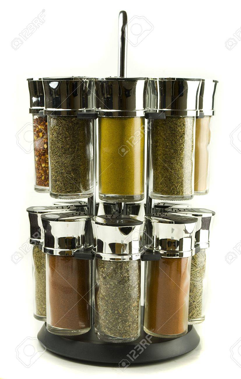 different spices rolling set in glass jars on wooden mat Stock Photo - 12606469
