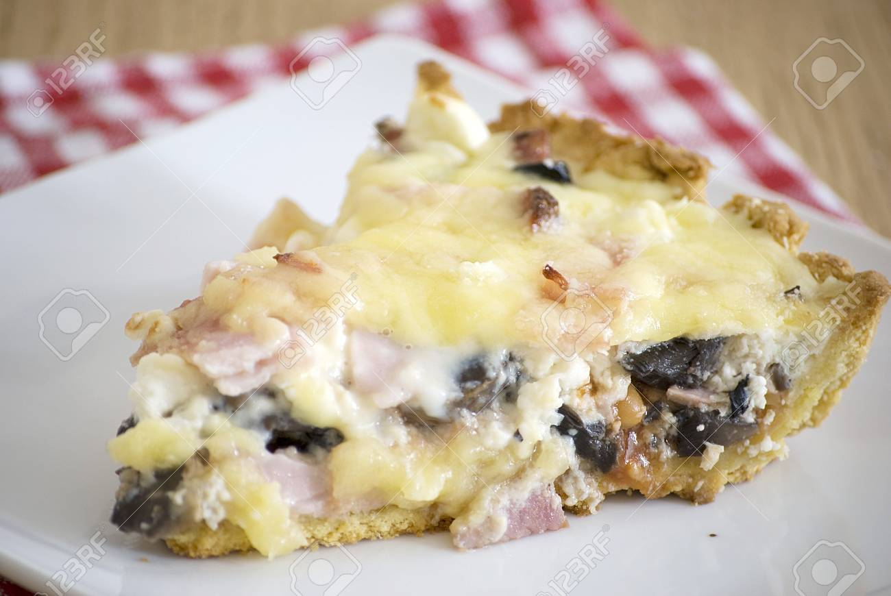 quiche with ham cheese salami muchrooms beans eggs in a white plate Stock Photo - 13725680