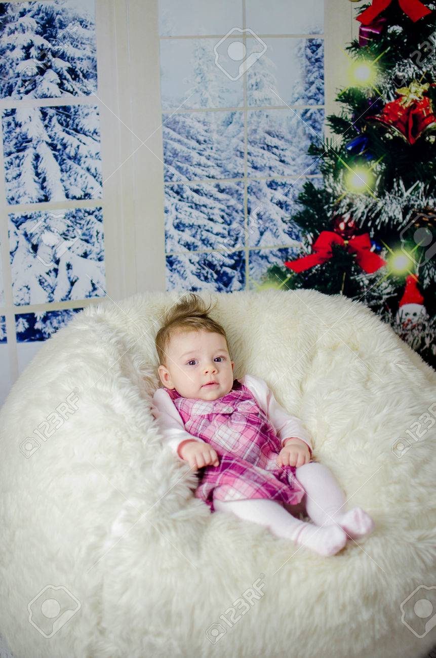 Baby Girl Enjoying Her First Christmas With Lots Of Gifts Under ...