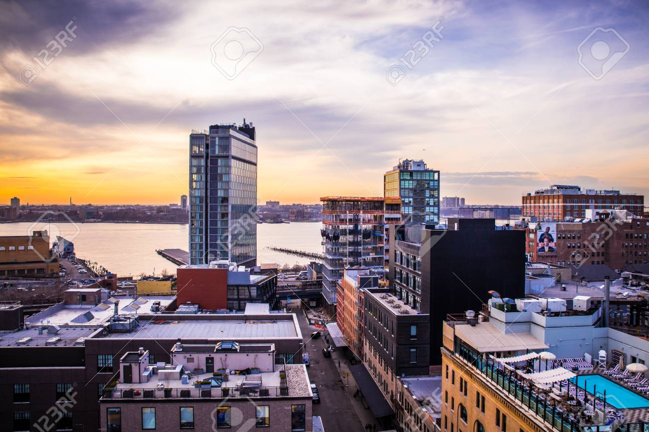 NEW YORK CITY - APRIL 6, 2015: View across Manhattan Meatpacking District and Chelsea from above, at sunset with The Standard Hotel in view. - 42240122