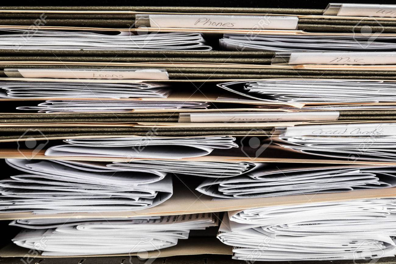 stack of papers bills invoices and financial statements in stock