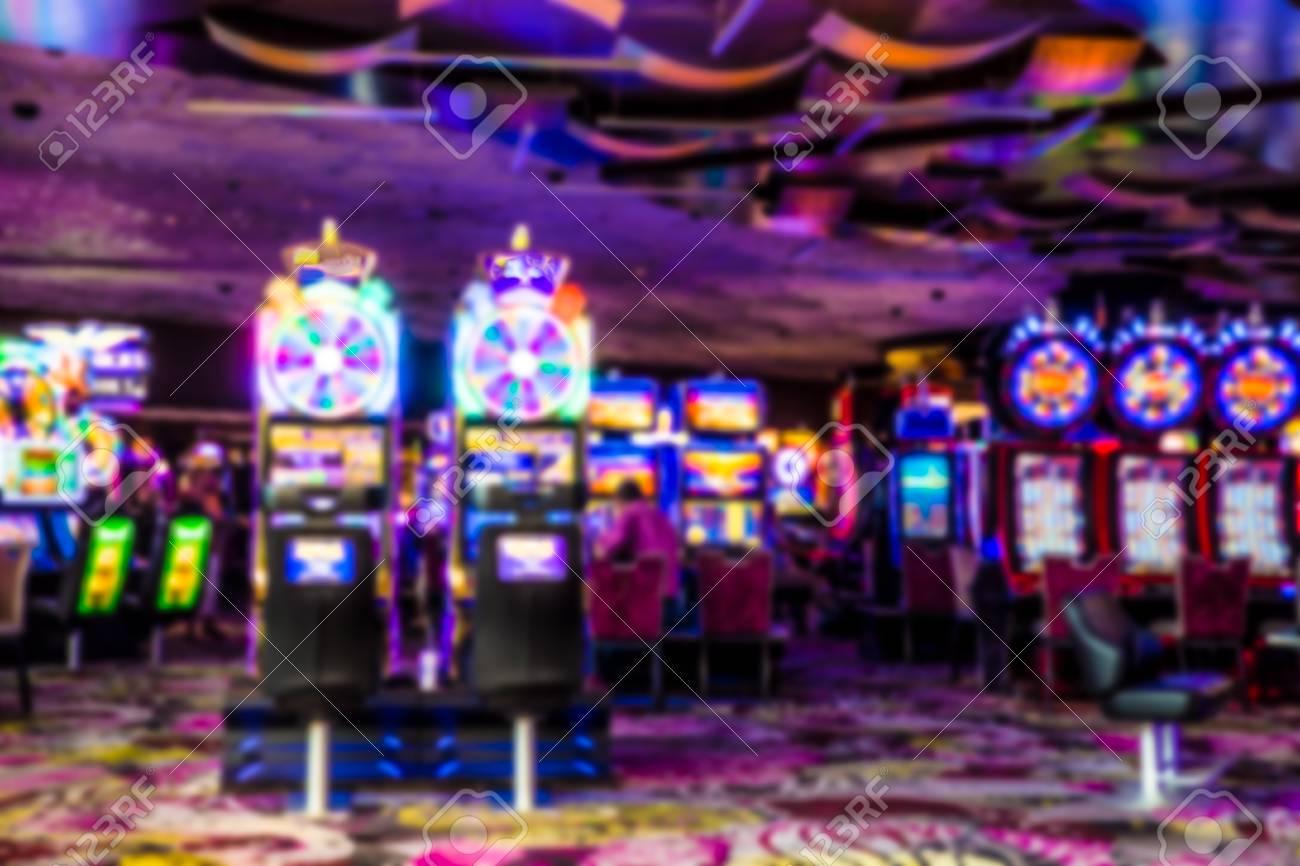 Colorful defocused blur of casino with slot machines - 117561758