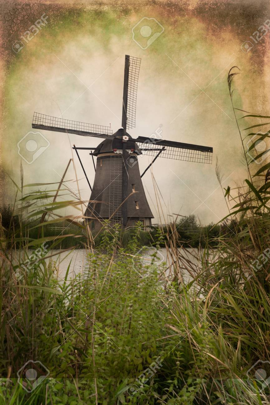 Traditional Dutch windmill with grunge vintage texture