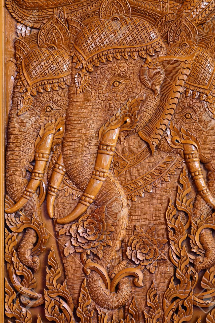 Wood carving pattern on the door of thai temple. stock photo