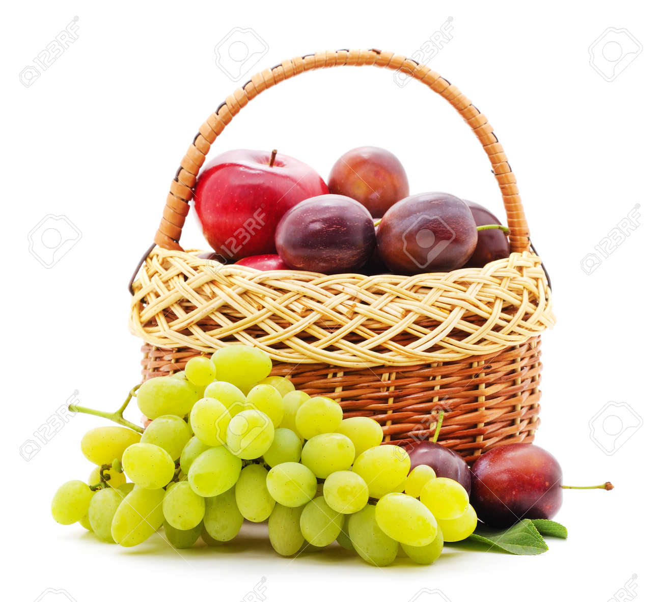 Fruits in a basket isolated on a white background. - 155326435