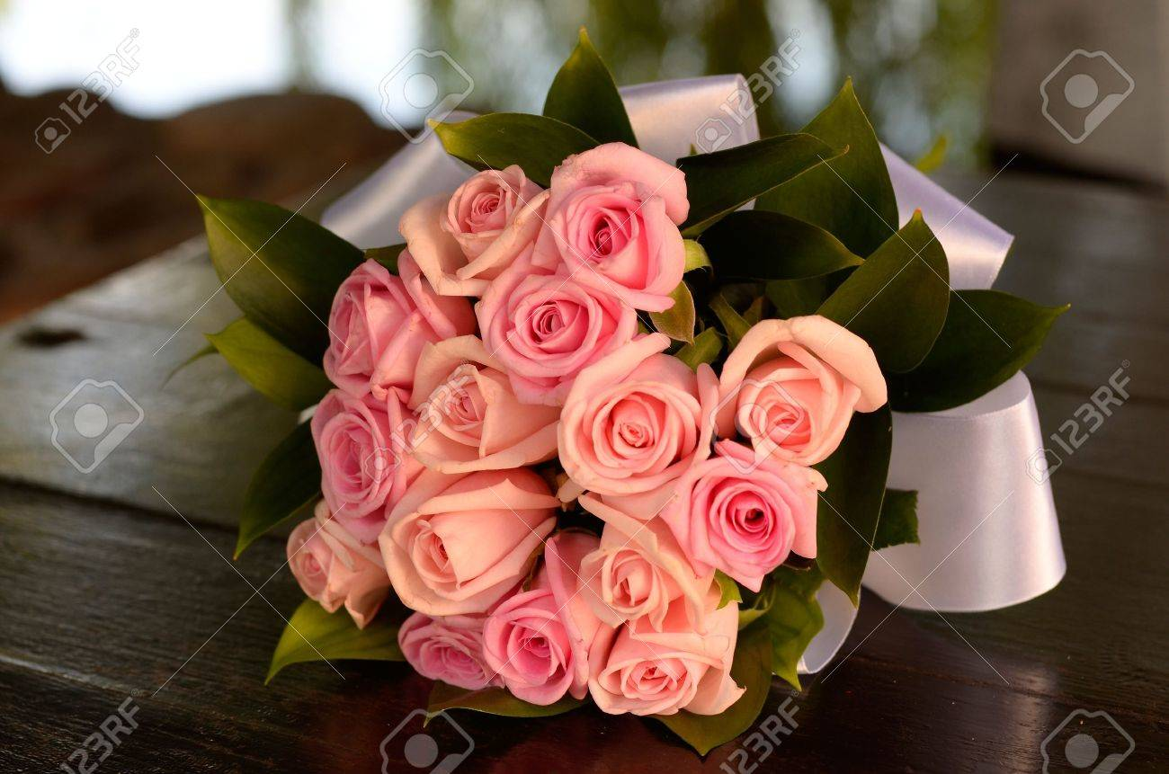 Bridal bouquet of pink roses on the table stock photo picture and bridal bouquet of pink roses on the table stock photo 10834396 izmirmasajfo Gallery