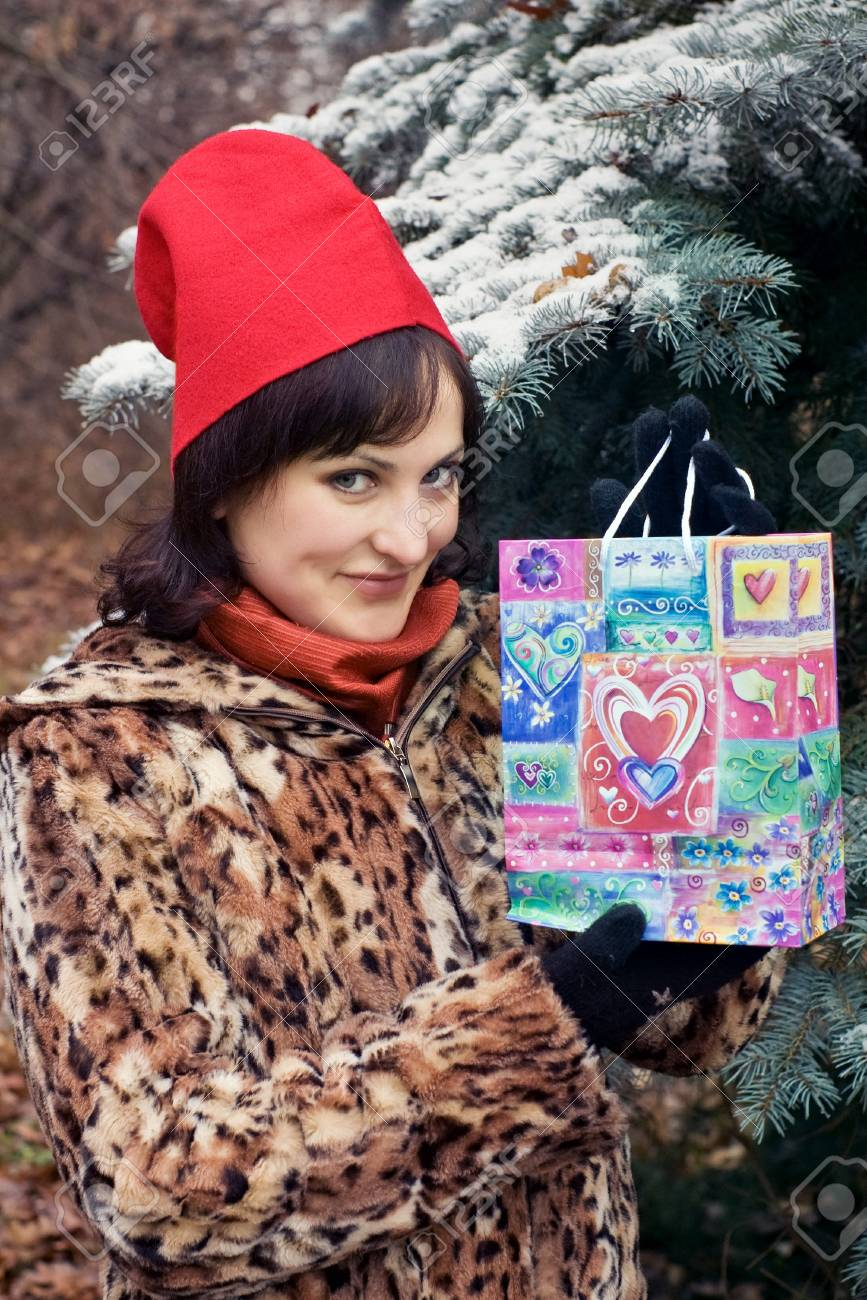 pretty female in red cap holding love present Stock Photo - 4296340
