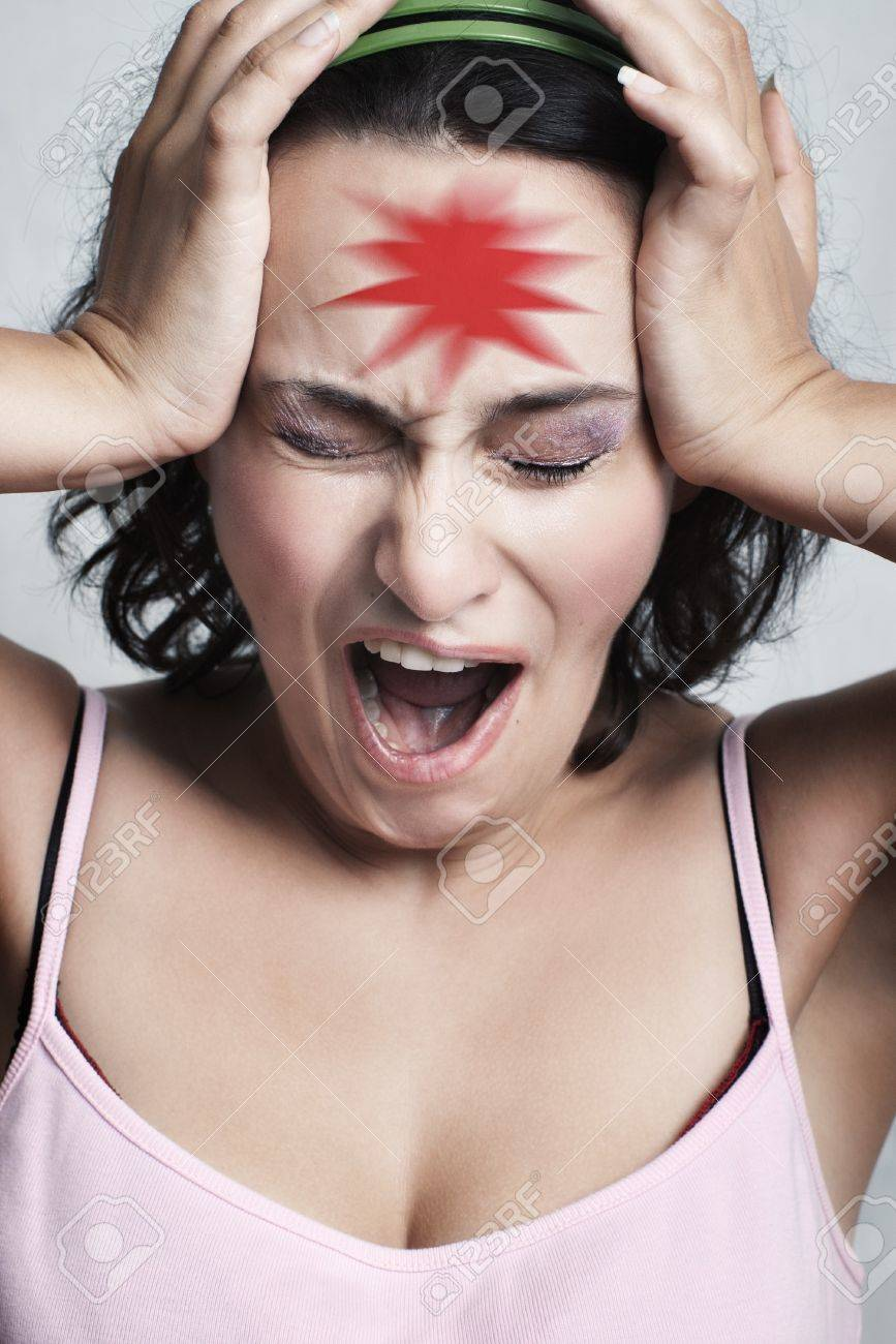 young woman screaming with closed eyes and red pain mark on her forehead with selective focus Stock Photo - 7449211