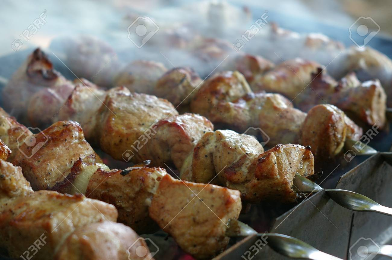 Closeup of pork meat on skewers with smoke and shallow depth of field Stock Photo - 9840437