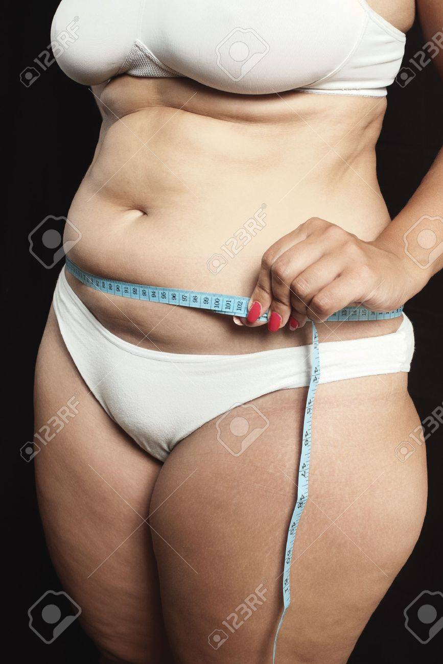 Woman measuring waistline with centimeter on black Stock Photo - 10282119