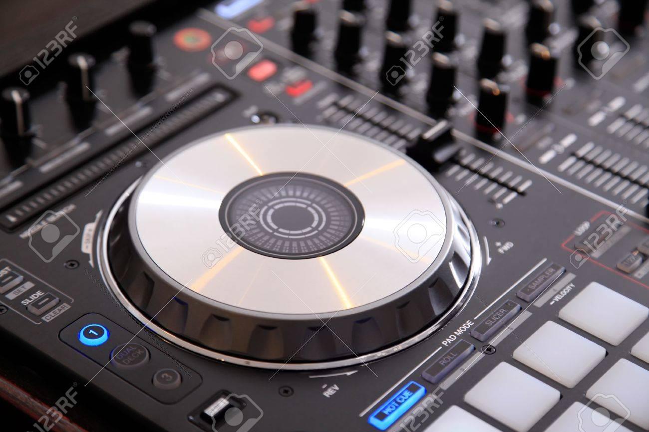Closeup of dj controller with jog wheel and selective focus