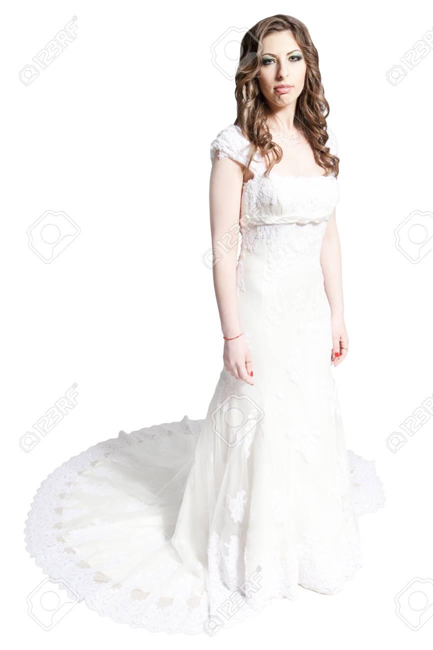 livraison gratuite 02f7c ae0e0 Jeune mariée debout dans la robe blanche avec le train isolé sur blanc