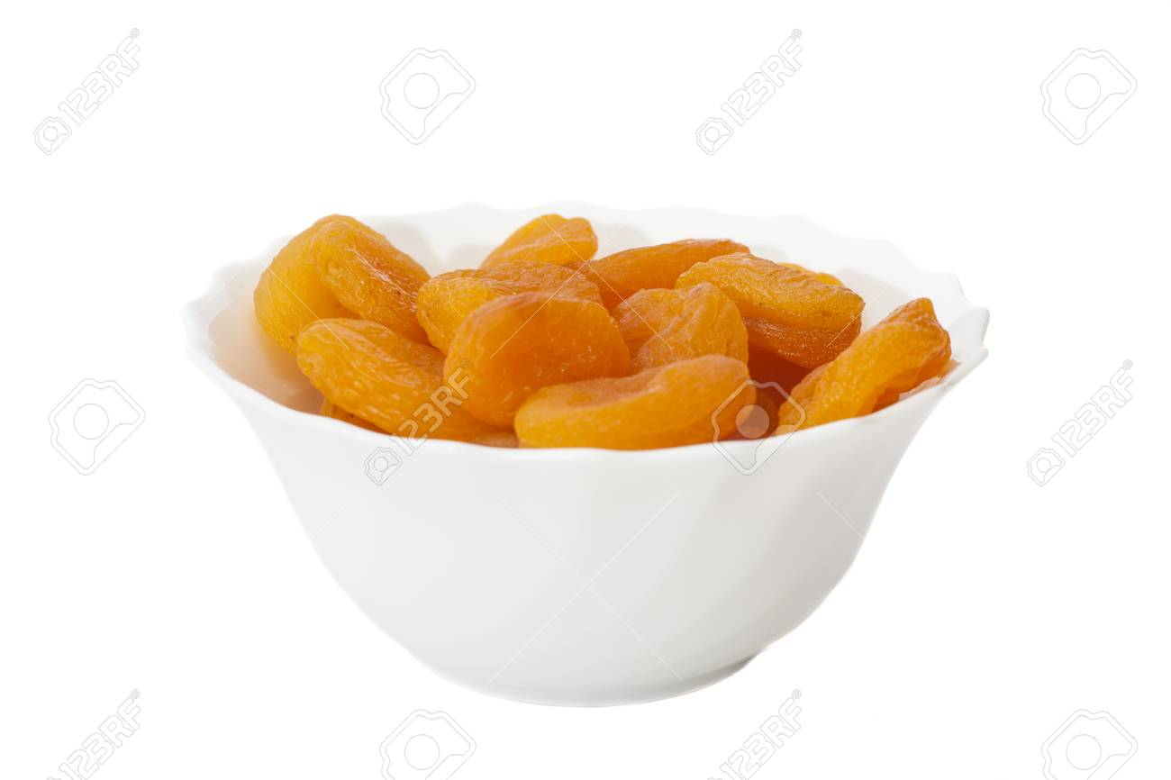 Dried apricots in bowl isolated on white - 30182304