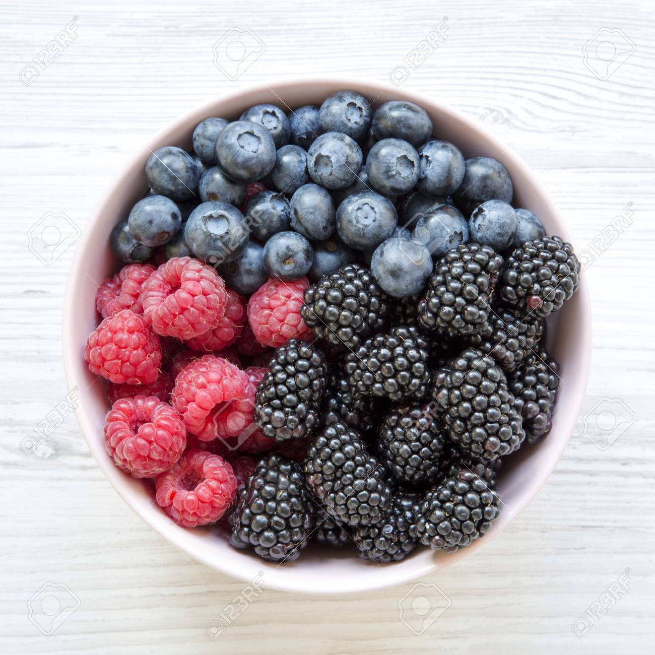 Pink Bowl Of Fresh Berries: Blackberry, Raspberry, Blueberry,.. Stock Photo, Picture And Royalty Free Image. Image 109287731.