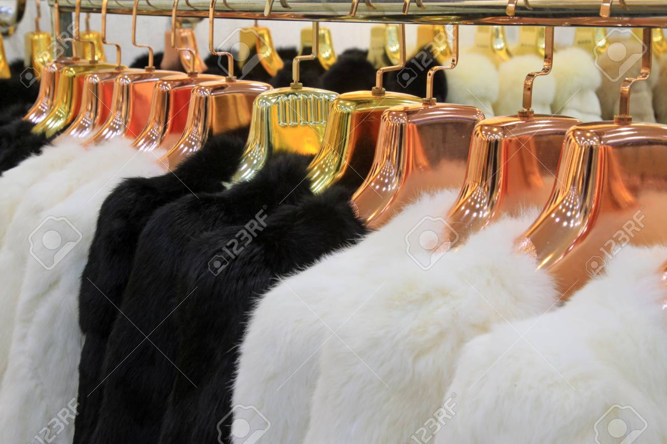 TANGSHAN CITY - NOVEMBER 16  The Fine fur clothing on hangers in a store, on november 16, 2013, tangshan city, hebei province, China Stock Photo - 26350403