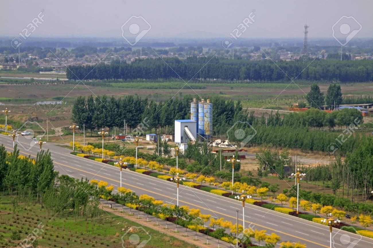 Roads and bituminous concrete mixing station, closeup of photo