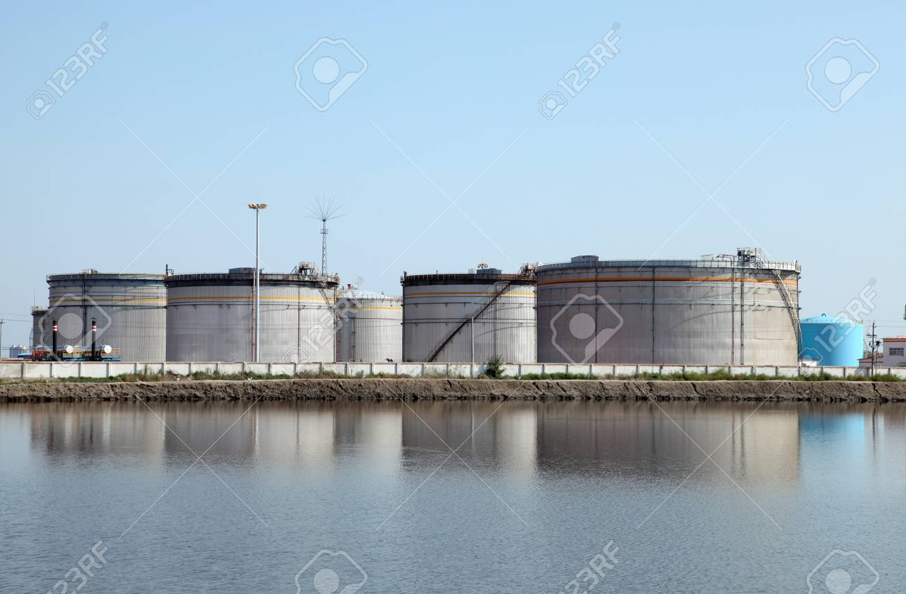Oil field scene Large oil storage tanks