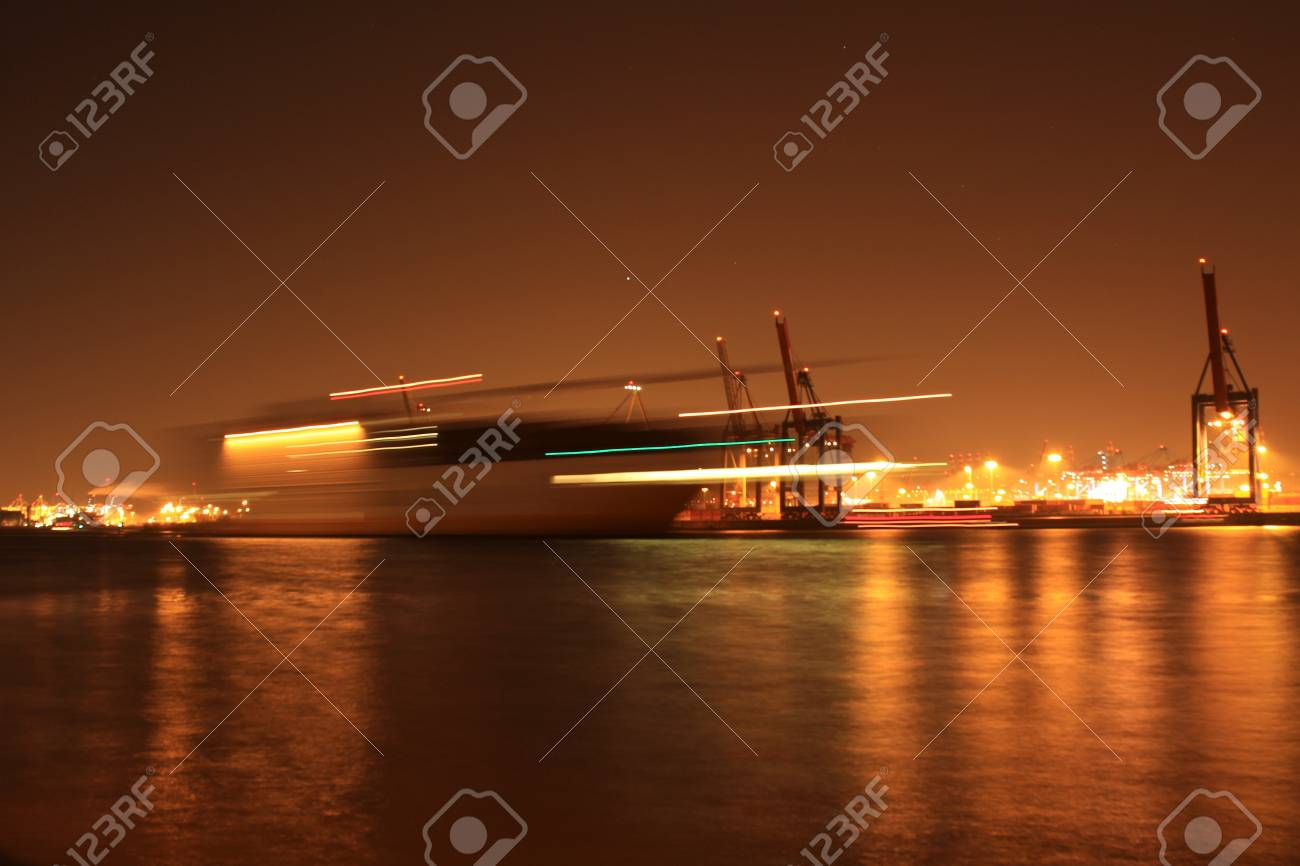A Ship In The Night Harbor Of Hamburg Stock Photo