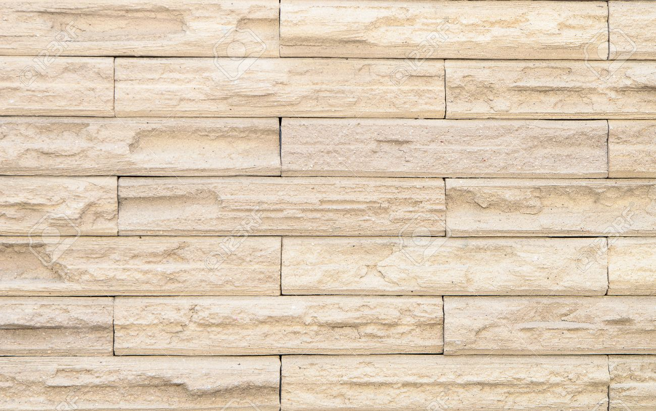 stock photo beige brick wall design as mortar background texture